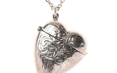 A VICTORIAN STYLE STERLING SILVER HEART SHAPE VESTA LOCKET ON CHAIN; 3.5 x 4cm scroll engraved case on a cable link chain, length 60...