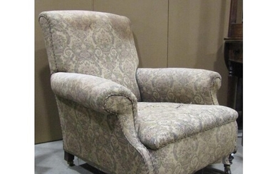 A Victorian easy chair with rolled arms, sprung seat and uph...