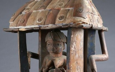 A Yoruba Nursing Figure in a Pavilion Hut
