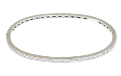 A brilliant-cut diamond hinged-bangle.