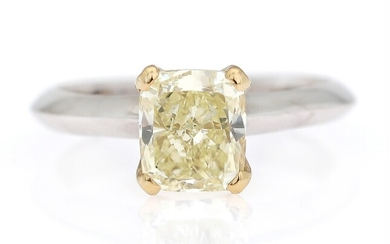 A diamond ring set with a cushion brilliant-cut diamond weighing app. 1.93 ct., mounted in...