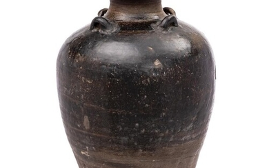 A large Vietnamese stoneware storage jar: of oviform with ra...