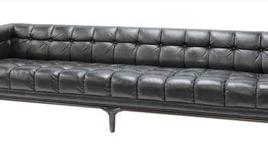 A large black leather button-upholstered settee