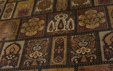 A large rug 12ft x 8ft approx oriental in design