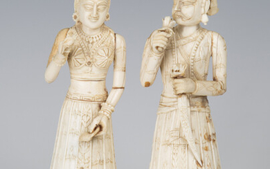 A pair of 19th century Indian carved ivory full-length figures of a lady and gentleman, height 18cm