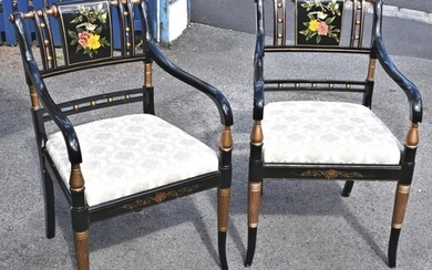 A pair of Regency style chinoiserie lacquered elbow chairs, ...