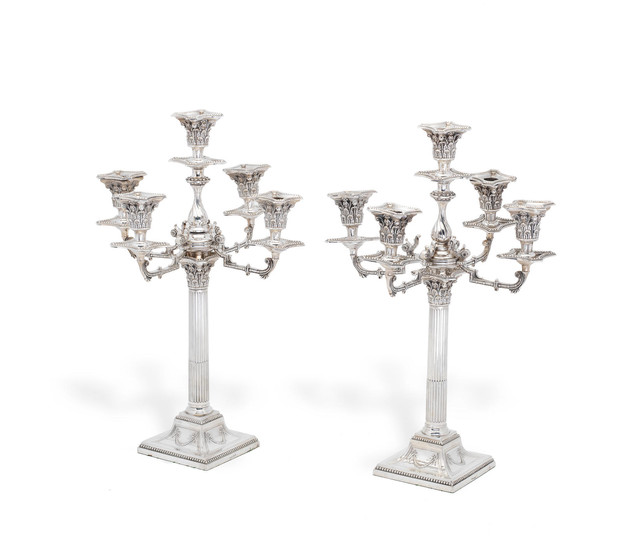 A pair of Victorian silver-plated five-light candelabra