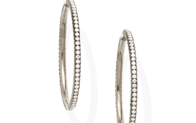 A pair of diamond and colored diamond hoop earrings