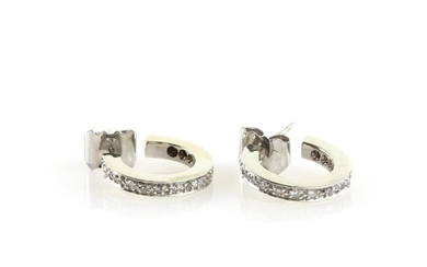 A pair of diamond set hoop earrings, each set...