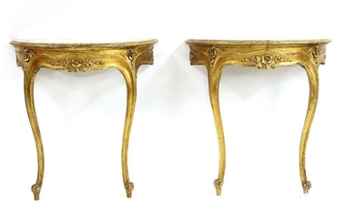A pair of giltwood demi-lune marble topped console tables