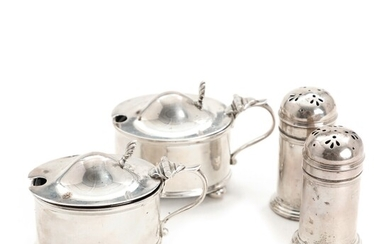 A pair of sterling silver salt cellars and a pair of pepper sprinklers. Walter &...