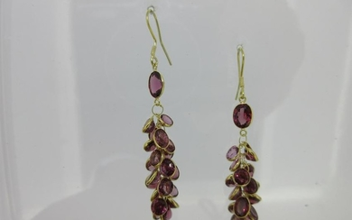 A pair of waterfall earpendants set with garnets,