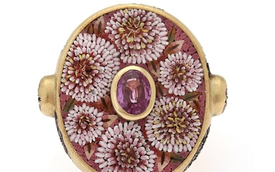A ruby ring set with an oval-cut riby encircled by glass mosaique and numerous circular-cut...