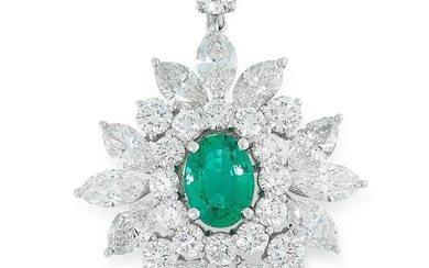 AN EMERALD AND DIAMOND CLUSTER PENDANT set with an oval
