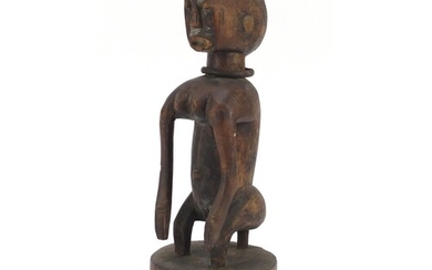 African tribal interest carved wood squatting Chamber figure...