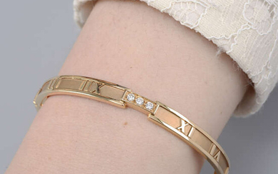 An 18ct gold diamond 'Atlas' bangle, by Tiffany & Co.