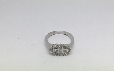 An 18ct white gold diamond 'boat' cluster ring set with roun...