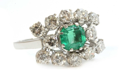 An emerald and diamond three row landscape-shaped cluster ring