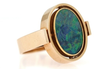 SOLD. An opal ring set with an polished opal, mounted in 14k gold. Size app....