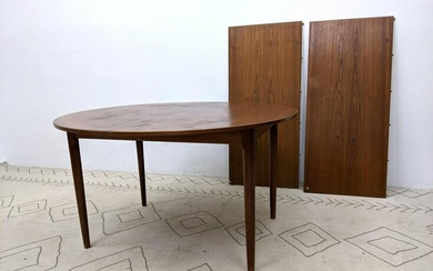 Danish Modern Teak Dining Table. Round top on tapered l