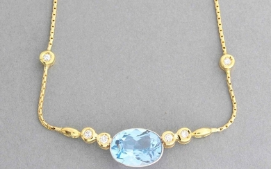 Gold necklace decorated with a golden aquamarine shoulder...