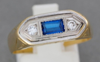 Gold ring set with a stone shouldered with two diamonds...