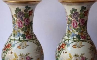 Pair of painted porcelain vases with polychrome decoration...