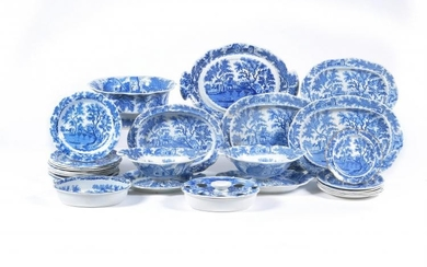 The remnants of a Henshall & Co. blue and white printed pearlware 'Castle & Bridge' pattern dinner service