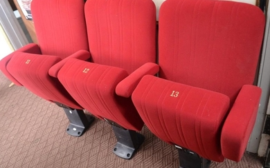 Three folding cinema seats. Numbered 11, 12 and 13 from a lo...