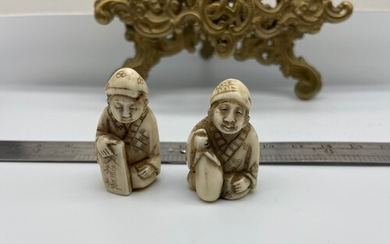 Two Japanese Meiji period hand carved ivory netsukes. Signed...