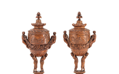 Two similar carved and turned stained lindenwood souvenir cups and covers