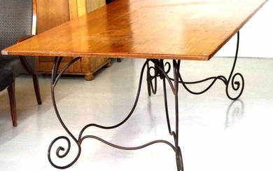 Very large wrought iron table with wooden top. 225cm, by 130...