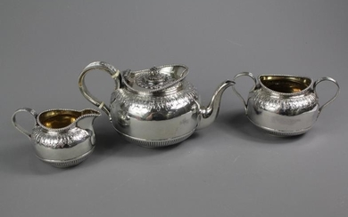 Victorian sterling silver three piece tea set; with raised...