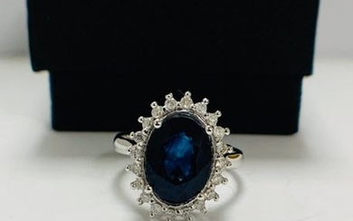 14ct White Gold Sapphire and Diamond ring featuring,...