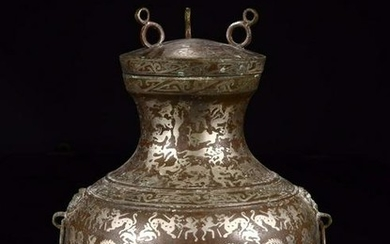 A SILVER-INLAID BRONZE HUNTER AND PREY PATTERN BOTTLE