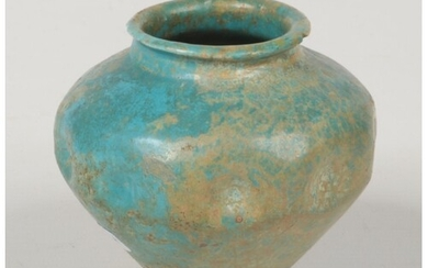 A 12th / 13th century Persian pottery small jar with turquoi...