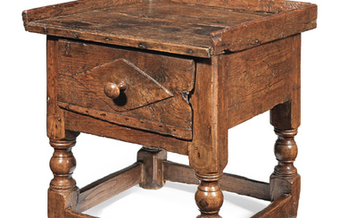 A 17th century small joined chestnut occasional table, Spanish