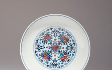 A CHINESE DOUCAI DISH QING DYNASTY Painted to the centre...