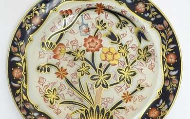 A Copeland plate decorated with flower and foliage with