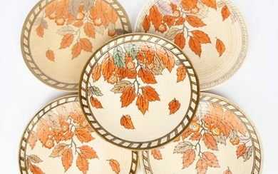 A Crown Ducal Golden Leaves wall charger designed...