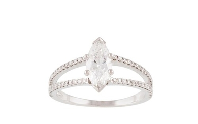 A DIAMOND SOLITAIRE RING, the marquise cut diamond to split ...