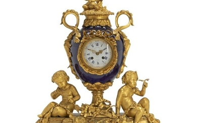 A French gilt bronze and porcelain mantle clock