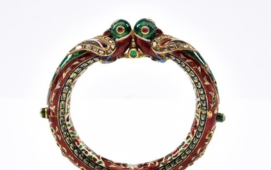 A GOLD, ENAMEL AND DIAMOND BANGLE-Of Eastern design set with red, green and blue enamel, with mine cut diamond detail, in 18ct gold.