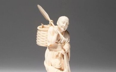 λ A JAPANESE IVORY CARVING OF A FISHERMAN, OKIMONO MEIJI PERIOD, 19TH CENTURY Depicting an elderly man holding a net in one hand and a long paddle in the other, a basket of fish hanging from it, smiling gently while a small child clings on to his leg...