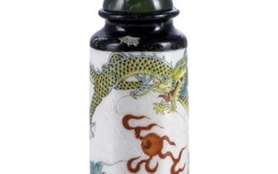A LARGE CYLINDRICAL PORCELAIN SNUFF BOTTLE DECORATED WITH PAINTED ENAMELS SHOWING TWO DRAGONS CHASING THE PEARL, China, Daoguang seal mark and of the period - H. 8 cm