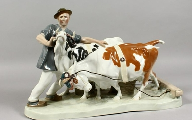 A LARGE MEISSEN PORCELAIN GROUP, farmer with two cows.