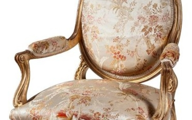 A Louis XVI style silk upholstered giltwood fauteuil...