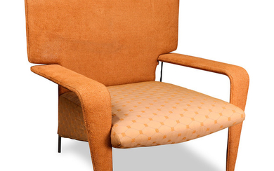 A Mid-Century Modern style orange upholstered lounge chair