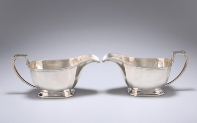 A PAIR OF ART DECO SILVER SAUCE BOATS, by Harrods Ltd