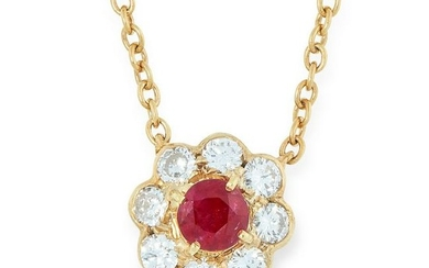 A RUBY AND DIAMOND CLUSTER PENDANT NECKLACE set with a